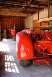 Two red tractors facing each other Royalty Free Stock Images