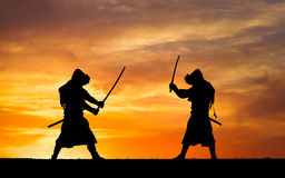 Picture with two samurais and sunset sky Royalty Free Stock Photo