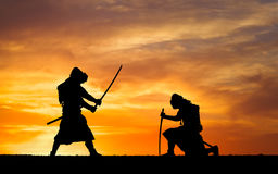 Picture with two samurais and sunset sky Royalty Free Stock Photography