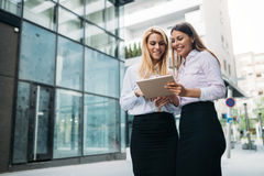Picture of two young beautiful women as business partners. Standing outside Stock Photo