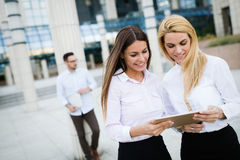 Picture of two young beautiful women as business partners. Standing outside Stock Photography