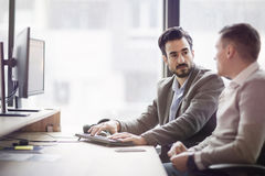 Picture of two young businessmen having discussion Royalty Free Stock Images