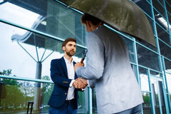 Picture of  two young businessmen meeting at station background Royalty Free Stock Image