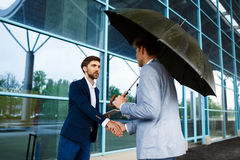 Picture of  two young businessmen meeting at station background Stock Photos