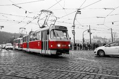 The typical red tram in Prague. A picture of the typical red tram in Prague, Czech Republic. The tram is isolated in the black and white background royalty free stock image