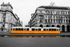 Typical yellow tram in Budapest. A picture of the typical yellow tram in Budapest, Hungary. The tram is in the black and white background stock photo