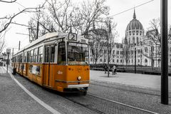 Typical yellow tram in Budapest. A picture of the typical yellow tram in Budapest, Hungary. The tram is isolated in the black and white background stock images