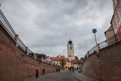 Upper town of Sibiu, in Transylvania, during a cloudy afternoon in a medieval street of the city. Royalty Free Stock Photos
