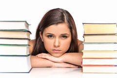 Picture of upset student with stack of books. Stock Image