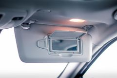 Vanity mirror open in the car Royalty Free Stock Photo