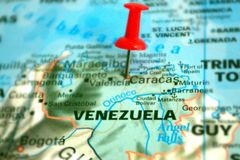 Picture of Venezuela located on a world map with the help of a red pin stock images