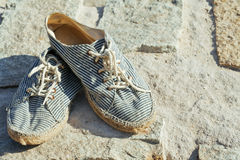 Picture of vintage old shabby sneakers at seacost Stock Image