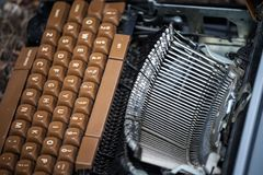 Old and broken typewriter, obsolete, with the blades and the QWERTY keyboard remaining following heavy damage caused by age. Picture of a vintage typewriter royalty free stock image