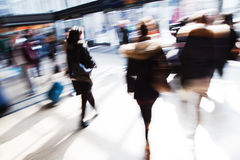 Walking people at the station. Picture of walking people at the station, shown in motion blur Royalty Free Stock Image