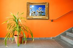 Picture on a wall and plant Royalty Free Stock Photography