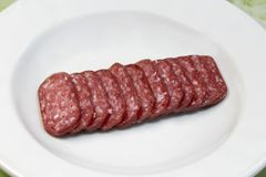 sausage in plate in other corner Royalty Free Stock Images