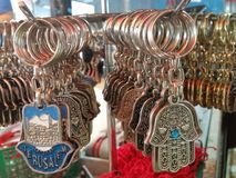 A Couple Of Silver Key Holders In The Shape Of Arabic Hamsa Talisman With Jerusalem And The Hebrew Word Alive. The picture was taken in Carmel market, tel aviv Royalty Free Stock Photos
