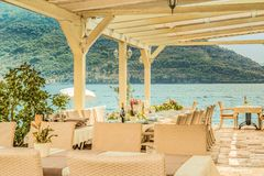 Fragment of the old cafe on the water is a favorite tourist place with a delicious local cuisine and a beautiful view of the Bay o. This picture was taken in Royalty Free Stock Photography