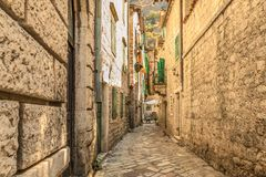 A street of the Old Town of Kotor. The old part of Kotor is a UNESCO World Heritage site and a famous tourist attraction. Royalty Free Stock Photo
