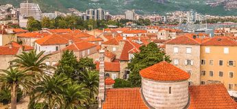 View of the old town of Budva: ancient walls, buildings with a red tiled roof - it`s something like a mini Dubrovnik in Croatia. This picture was taken in Stock Images