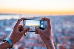A man taking a picture of the cityscape stock images