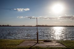 Rusty shower on a beach facing the Blue water of Palic Lake, in Subotica, Serbia, during a summer sunset. Picture of the waters of the Palic Lake during a summer stock images