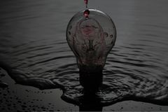 Bulb and wather. Picture of wather falling on the bulb with red filter Royalty Free Stock Photo
