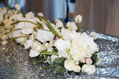Picture of wedding bouquet of white roses on table as decor Stock Photo