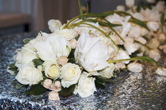 Picture of wedding bouquet of white roses on table as decor Royalty Free Stock Image