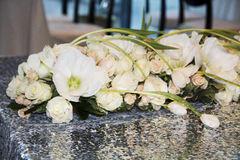 Picture of wedding bouquet of white roses on table as decor Royalty Free Stock Photos