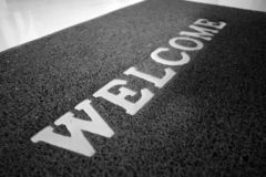 Welcome home Doormat, black and white. stock photo