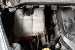 Picture of what the car under the hood. Engine, expansion tanks for oils and fluids.  Stock Images
