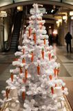 Picture of white Christmas tree decorated with carrots. On blurred background in store Royalty Free Stock Photos