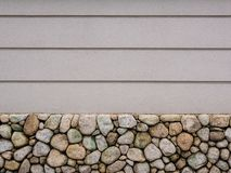 Picture of white concrete wall with stones at the basement and vertical several lines. Picture of white concrete wall with stones at the basement and vertical royalty free stock images