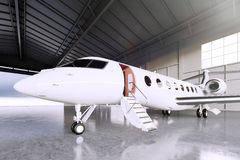 Picture of White Matte Luxury Generic Design Private Jet parking in hangar airport. Concrete floor. Business Travel Royalty Free Stock Photos