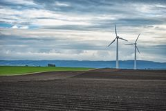 Picture of wind farm generators in the green field. Stock Photography