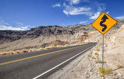 Picture of a winding road ahead sign Stock Photo