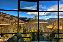 picture window with a view of mountain lake stock image