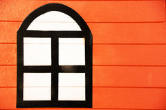 Picture window on the wooden wall. Orange Royalty Free Stock Image