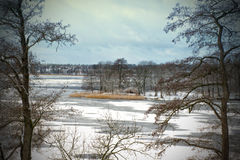 Picture of winter in wooden frame. Picture of frozen lake in wooden frame Royalty Free Stock Photography
