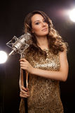 Picture of woman in black with microphone Royalty Free Stock Image