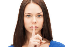 Picture of woman with finger on lips Stock Photography