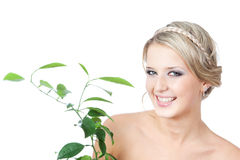 Picture of woman with green plant over white Royalty Free Stock Photo