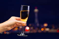Picture of woman hand holding champagne glass Stock Photo