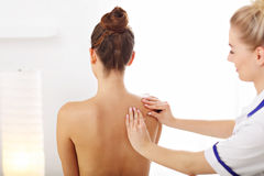 A picture of woman having back therapy royalty free stock photos