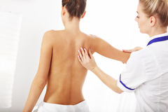 A picture of woman having back therapy stock photos