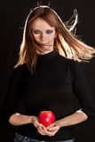 Picture of woman holding a red apple Royalty Free Stock Photos