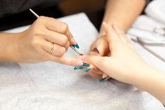 Picture of woman at manicure procedure. At spa salon Royalty Free Stock Photography