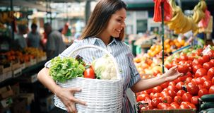 Picture of woman at marketplace buying fruits. Picture of beautiful woman at marketplace buying fruits stock images