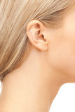 Picture of woman's ear. Bright closeup picture of woman's ear royalty free stock photos